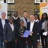 Werner Weiss hands over bursary to Anna Amupolo of Namibia University of Science and Technology